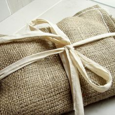 what a great idea- using burlap as gift wrapping.  looks amazing!