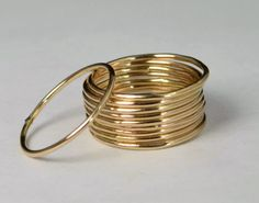 """Thin Round Gold Filled Stacking Ring: Dainty, rustic, and original. Each ring is different as I leave the solder joint untouched adding texture, occasional """"dew drops"""" of gold, and other """"imperfec Dainty Gold Rings, Boho Rings, Jewelry Rings, Stone Jewelry, Silver Rings, Real Gold Jewelry, Gold Jewellery Design, Jewellery Box, Indian Jewelry"""