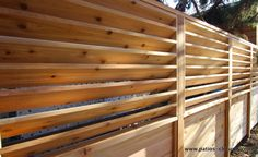 Fence with fixed horizontal louvers
