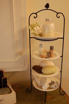 use a plate stand to create extra space on the bathroom counter or for jewelry storage