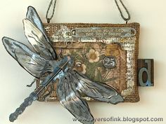 Layers of ink - Dragonfly Burlap Panel Tutorial, with Tim Holtz idea-ology papers and embellishments, Sizzix dies, and Wendy Vecchi Modeling Film.