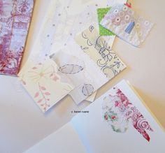 Make small book with watercolor pages. Add scraps of paper and fabric. Karen Ruane sells them in her shop for people to use as a journal or other sweet little book.♥