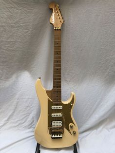 Washburn custom shop ivory electric guitar made in the USA.
