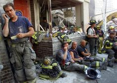Firemen gather at a destroyed firehouse next to the fallen World Trade Center towers as they take a break from resuce efforts in New York September 13, 2001. The World Trade Center towers collapsed September 11 after being attacked with hijacked commercial airliners. / This is The Ten House, Engine 10, Ladder 10. They lost 6 firefighters. (Credit: © STR New / Reuters)