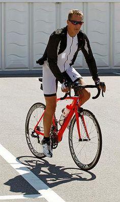 Michael Schumacher rides a bike.