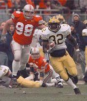 Michigan beats Ohio State 2000 Michigan Running Back Anthony Thomas (32) Eludes A Tackler
