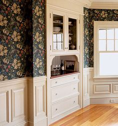 Poplar was used for the raised-panel wainscot and built-in buffet in a Massachusetts house. Photo by Eric Roth