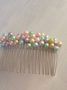 Multi get coloured beaded/ roses hair comb  on Etsy, £9.00