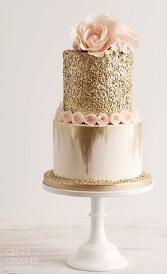 Featured Cake: De la Creme Studio; Chic glittery gold two tier wedding cake topped with blush flowers