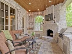 Love this backyard stone #Fireplace! And there's a #Grill built in as well. Makes cooking outdoors feel luxurious!