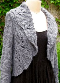 Interesting light cabled sweater. Cable inspiration for me, but you can also buy the pattern from the site.