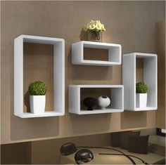 Conjunto de 4 Nichos Decorativos Milão, com design moderno e multifuncional, esse nicho vai valorizar e decorar as paredes do seu ambiente de escritório, comércio, residência. Com ele é possível organizar ambientes pequenos com praticidade. <br>Nicho produzido em MDF 15 mm <br> <br>Imagem com as cores disponíveis <br> <br>2 = 0,45 x 0,25 x 0,15 <br>1 = 0,40 x 0,20 x 0,15 <br>1 = 0,35 x 0,15 x 0,15