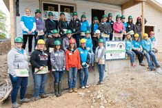 Habitat hosted a one-day Executive Women's Build this month in Sun Prairie's Vandenburg Heights neighborhood. Thirty female executives spent the day on the construction site, Deb Alton ( next to the sign in front) was part of the action and networking for this great event!