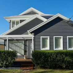Did you know that Scyon weatherboards and cladding can be painted any colour you like? A Hamptons look is achieved here by using Dulux Western Myall with white, but it can also be achieved using blue or grey tones, or neutrals. Weatherboard Exterior, Grey Exterior, Exterior Cladding, House Paint Exterior, Exterior Design, Exterior Houses, Bungalow Exterior, Exterior Color Schemes, Exterior Paint Colors