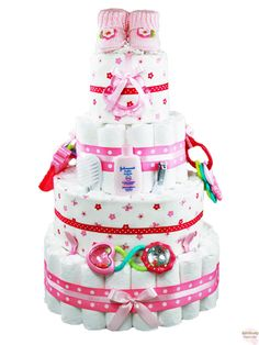 It doesn't get any more girlie than our Flowers & Booties Diaper Cake.  Decked out in pink baby items from top to bottom, this diaper cake will fit in perfectly with any pink nursery or baby shower theme.  Simply put, it is 'bootiful'!  http://www.rattlecake.com/diaper-cakes/flowers-and-booties-diaper-cake-4-tier.html  $149