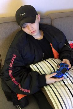Woozi fell asleep playing video games~ And he denies his adorableness.