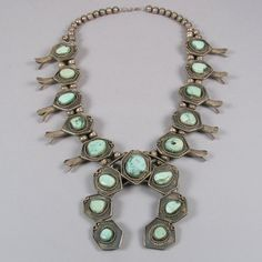 *|*  Vintage Navajo Squash Blossom Necklace.  Circa late 1950s, early 1960s.  Material:  Silver and Turquoise.