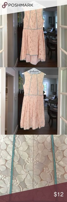 Sleeveless pale pink dress with high-low hem. Dreamy and whimsical dress. Sleeveless with high neckline. Pale turquoise trim. Floral fabric. Pale pink. Low-high hemline. Perfect to dress up or dress down. Great condition - barely worn! DeJaVu Dresses High Low