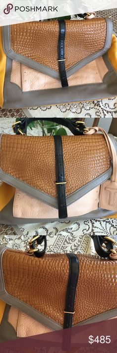 Tory Burch 797 Satchel Excellent condition with little minor marks(just worth mentioning)..used handful of times..pristine inside. Sold out color!!!comes with shoulder strap and dustbag Tory Burch Bags Satchels