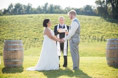 Wine barrels make perfect DIY altars - especially at wineries! | Alice & Chad's DIY Purple & Sunflowers Maryland Barn Wedding at Linganore Winecellers. Images by Photography by Brea.