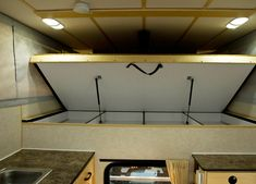 FLEET FLAT BED MODEL - Four Wheel Campers | Low Profile, Light Weight, Pop-up Truck Campers