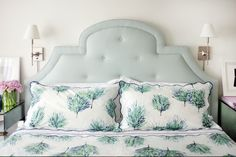 Love the color of this headboard - the seafoam hue is perfectly between a blue and a gray. Would tie the room together beautifully.