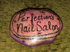 Painted rock creations!  This rock was painted in honor of my nail salon.  I used Azure thermal gel nail polish that turns from light pink to purple.  I used Caption high gloss gel top coat to make it shine!