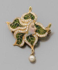 An Art Nouveau diamond, enamel and 18K gold brooch/pendant.  Vintage jewelry.