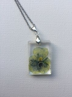 Viola Flower Rosin Necklace - Small rectangle by ShellsArtGarden on Etsy Handmade Necklaces, Handmade Items, Handmade Gifts, Clear Resin, Stainless Steel Chain, Dried Flowers, Necklace Lengths, Jewelry Collection, Pendants
