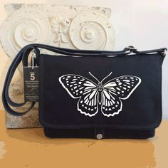 """We delight in the beauty of the butterfly, but rarely admit the changes it has gone through to achieve that beauty."" - Maya Angelou 🐛🦋 Celebrate your creative journey with a handcrafted Dock 5 Butterfly messenger bag!"