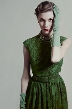 1950s fashion green dress leaf print color photo print ad model magazine full pleated skirt belt sleeveless day cocktail late 40s early 50s gloves necklace vintage fashion style