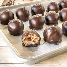 These chocolate chip cookie dough truffles are rich and decadent made with raw cookie dough dipped in dark chocolate and have little flakes of sea salt on top. Cookie Dough Dip, Cookie Dough Truffles, Chocolate Chip Cookie Dough, Christmas Appetizers, Christmas Desserts, Christmas Cocktails, Christmas Games, Coffee Games, Chocolate Crinkles