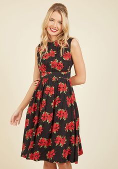 Too Much Fun A-Line Dress in Poinsettias - Long. Theres no such thing as overloading on fun - but if it were possible, why not go all-out in this black A-line! #black #modcloth