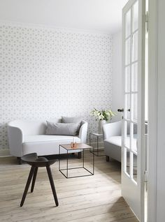 Flemming Lassen's Mingle sofa, Flow cushions inspired by the Mogens Lassen wallpaper, Flow, and a tiny table called Twin with reversable table top.