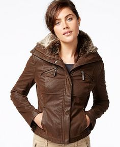 Add a little rocker-chic to your outfit with this faux-leather bomber jacket by Jou Jou complete with a faux-fur hood so you can be warm and stylish!