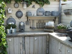 "self-built outdoor kitchen with concrete countertops and scaffolding wooden doors."" By - via Welke Outdoor Rooms, Wood Doors Interior, Outdoor Kitchen Design, Kitchen, Concrete Countertops Kitchen, Outdoor Kitchen, Build Outdoor Kitchen, Kitchen Hacks Organization, Outdoor Cooking"