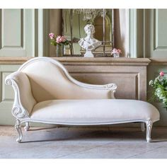Provencal White Chaise Longue | Chaise Longue | French Furniture With an elegantly carved antique white mahogany frame, upholstered in a simple ivory and white soft ticking cotton, scrolled arm, and curved back, this luxury chaise longue is a step closer to your ultimate boudoir!