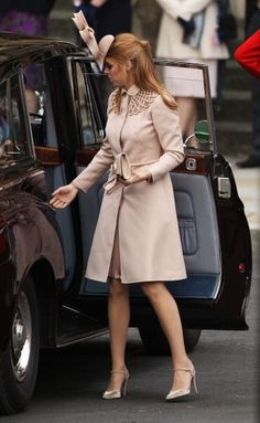 4/29/11 - Princess Beatrice stepping out of the car.