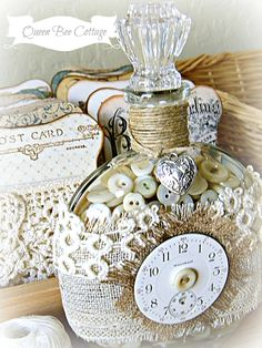 Time and glass buttons in a bottle, if buttons could speak. :) Lace card bobbins.