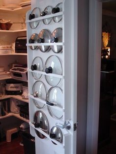 Lid Racks Or use the back of the door to store notoriously un-organizable pot lids. Worthing Court featured a pantry with custom-build pot l...