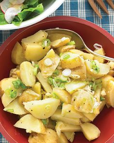 Tangy Potato Salad with Scallions!  Looks like a great dish to bring to a potluck.