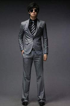 A very nice casual business suit. The pants are a loose boot cut but fits with the rest of the outfit. It's hard finding the right tie to make a suit work, but this one gets it just right.