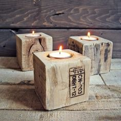 wood block candle holders - this would be easy to do with wood offcuts and a holesaw bit or spade bit attached to your drill