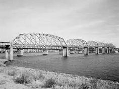 This photo looking from Mo to IL shows the Alton Bridge, the Alton Railroad bridge, old Lock and Dam No.