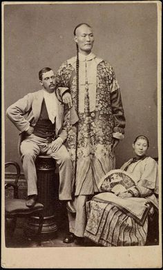 Chang 'the Chinese giant' in 1871, with his wife and manager. He was nearly 8' tall.