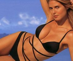Heidi Klum has an entire book of sexy mostly nude pictures of herself, why is she shy about Playboy? She would prefer to keep things artsy and tasteful. She also doesn't need the money as she has other priorities in her life that she would rather use the time for.