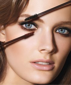 Open your eyes use contrasting mascaras. For a more natural version go jet black on top with a rich brown on bottom for a doe-eyed look.
