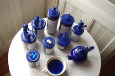 "Silva Kuha, The Blue Flowers ""ALICE IN WONDERLAND"" TEA COLLECTION:  I have created a special ""Alice in the Wonderland"" world in all of my tea jars. There is different blue flower teas: Lavender Tea, Corn Flower Mix, Earl Grey Blue Star, Blue Malva flowers and Dark Blue Malva flowers. http://theblueflowers.weebly.com/  p.s one of the teas Blue Malva is really blue like in that cup. Its also healthy tea."