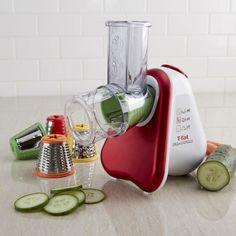 This compact electric food slicer/grater is simple to use, safe, and easy to clean. It quickly grates, shreds, or slices a variety of fruit, vegetables, cheeses, and even nuts! The unit comes with 5 colour-coded cones that each serve a different purpose.