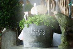 This uplifting planter found at the Bella Vintage Home booth is sure to improve any mood.   - CountryLiving.com